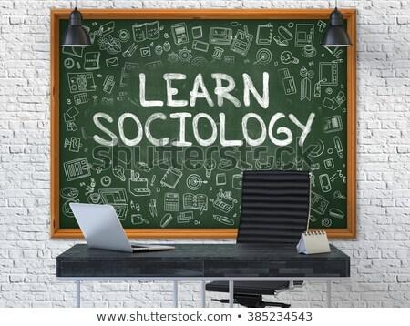 hand drawn learn sociology on office chalkboard stock photo © tashatuvango