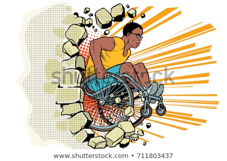 Black male athlete in a wheelchair punches the wall Stock photo © studiostoks