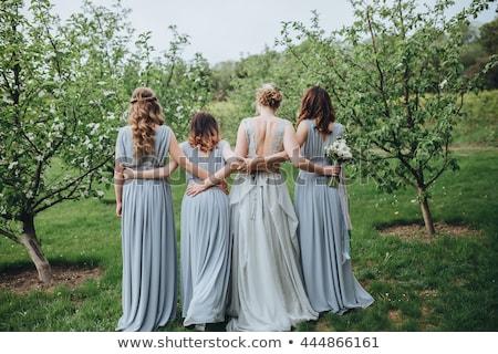 Menyasszony koszorúslány kert esküvő pár portré Stock fotó © IS2