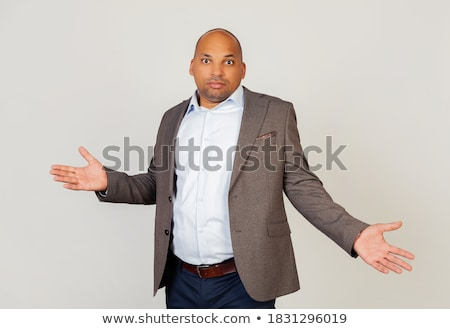 Confused african-american man with spread arms. Stock photo © RAStudio