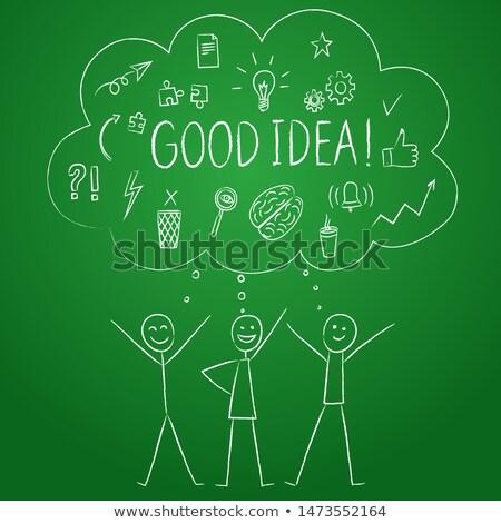 Teamwork - Cartoon Illustration on Green Chalkboard. Stock photo © tashatuvango