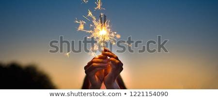 Jong meisje sterretje kind leuk jonge vuurwerk Stockfoto © IS2