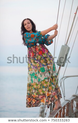 woman swinging between ropes of a boat Stock photo © IS2
