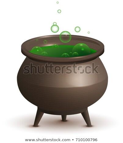 Large iron pot with green magic potion. Halloween accessory Stock photo © orensila