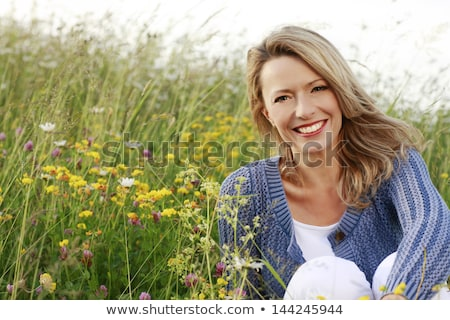 portrait of middle-aged woman and flower Stock photo © IS2