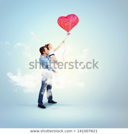 young children hugging red heart balloon stock photo © is2
