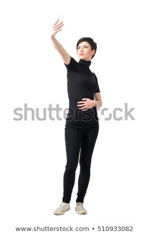 full body picture of a young woman in short pants  Stock photo © feedough