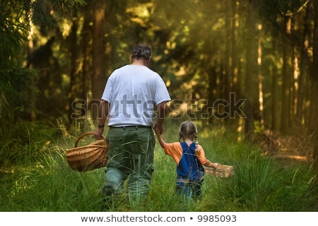 Family with mushroom baskets in forest Stock photo © IS2