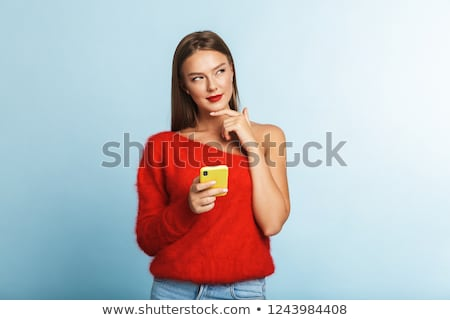 Cute young thoughtful lady standing isolated stock photo © deandrobot