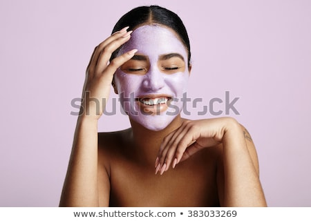 beautiful relaxed woman having green clay face mask stock photo © dashapetrenko