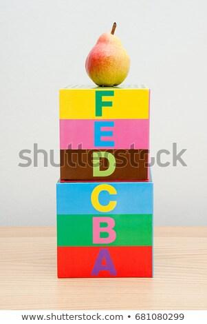 Pear on top of alphabet blocks Stock photo © IS2