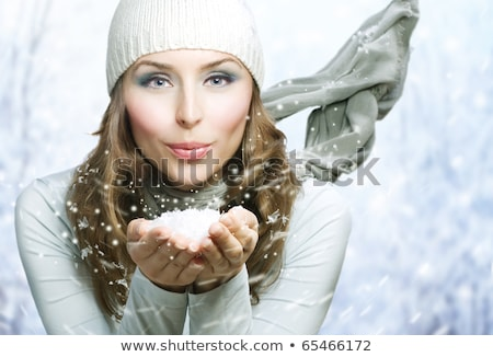 Portrait of girl with presents in snow Stock photo © IS2