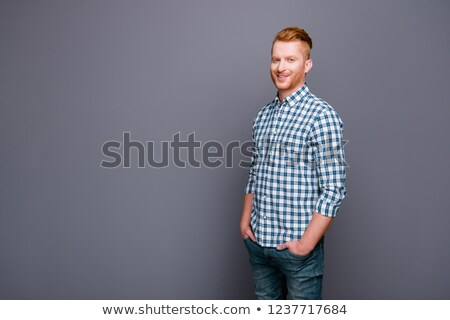 portrait of man with red checkers shirt looking to side Stock photo © feedough