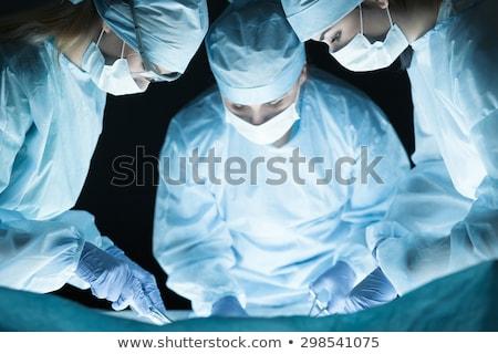 Stock fotó: Három · sebészek · beteg · nő · orvos · férfiak