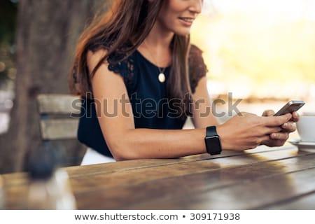 genç · kadın · oturma · restoran · çekici · telefon - stok fotoğraf © boggy