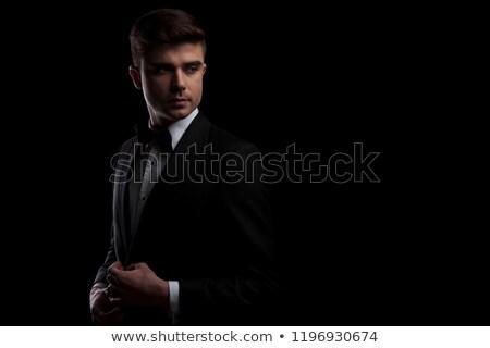 Retrato curioso elegante hombre azul traje Foto stock © feedough