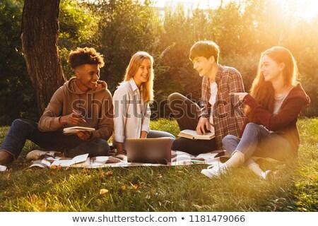 домашнее · задание · используя · ноутбук · сидят · полу · компьютер - Сток-фото © deandrobot