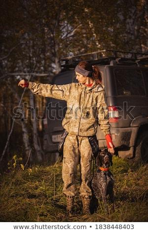 Kobieta hunter lesie jesienią polowanie sezon Zdjęcia stock © lightpoet