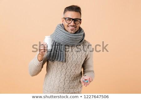 幸せ 若い男 セーター スカーフ 飲料 ストックフォト © deandrobot