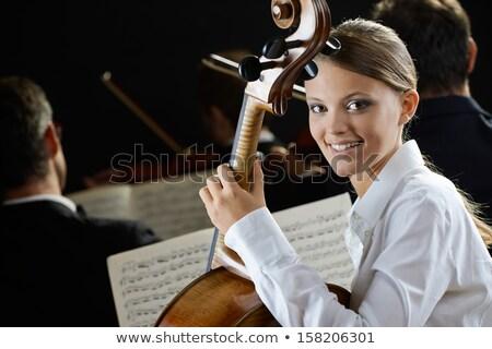 Młodych wiolonczelista muzyki arkusza przystojny gry Zdjęcia stock © ra2studio