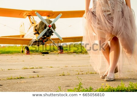 Bride on the vintage airfield Stock photo © boggy