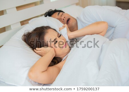 Bad Stressed men tired ears because snoring Stock photo © Lopolo