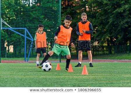 Chłopca piłkarz szkolenia uruchomiony praktyka dziedzinie Zdjęcia stock © matimix