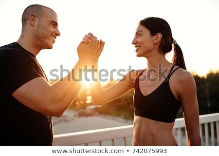 Stockfoto: Jonge · vrouw · arm · personal · trainer · geslaagd · opleiding · gelukkig