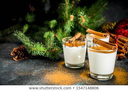 Traditional Christmas winter drink eggnog in glasses Stock photo © furmanphoto