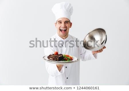 sorridente · açougueiro · carne · faca · profissional - foto stock © deandrobot