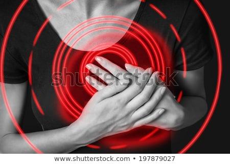 Woman clutching breasts. Stock photo © iofoto