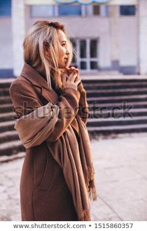 blond · vrouw · witte · jas · alleen · buitenshuis - stockfoto © giulio_fornasar