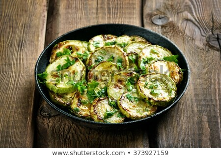 Fried zucchini slices with parsley stock photo © furmanphoto
