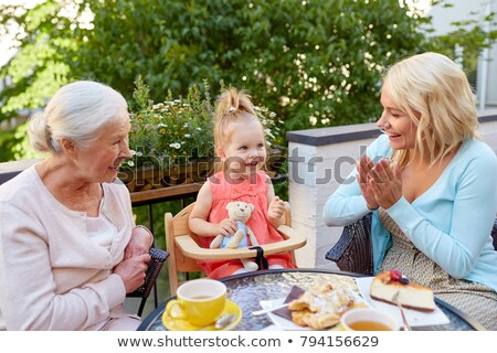 mother daughter and grandmother at cafe stock photo © dolgachov