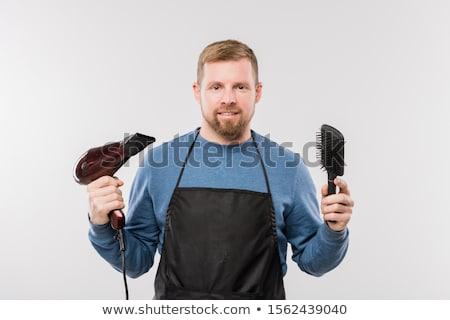 Boldog fiatal szakállas fodrász kötény tart Stock fotó © pressmaster