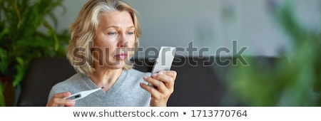sick senior woman with thermometer Stock photo © dolgachov