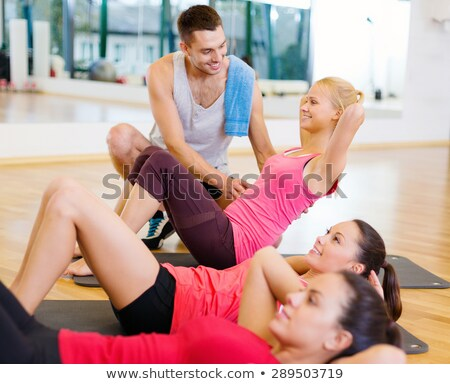 Man and woman doing stomach or abdominal exercises together Stock photo © Kzenon