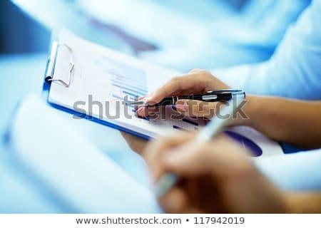 Businesswoman Writing On Graph Stock photo © AndreyPopov