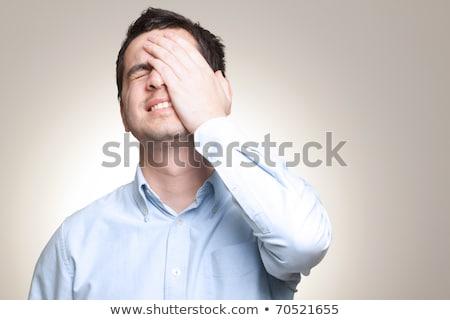 Portrait of young sad man worrying or having pain  Stock photo © dacasdo