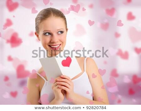 Ravi femme lecture Valentin carte de vœux coeur Photo stock © HASLOO