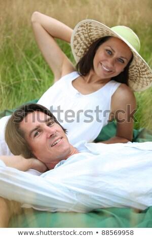 40 années vieillard femme détente couché prairie Photo stock © photography33