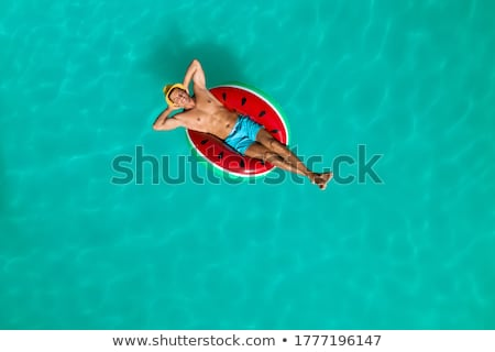 Stock photo: Man by the pool