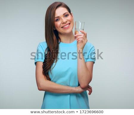 Barna hajú tart üveg víz nő égbolt Stock fotó © photography33