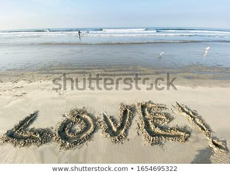 Valentin un message sable écrit plage tropicale Photo stock © bobhackett