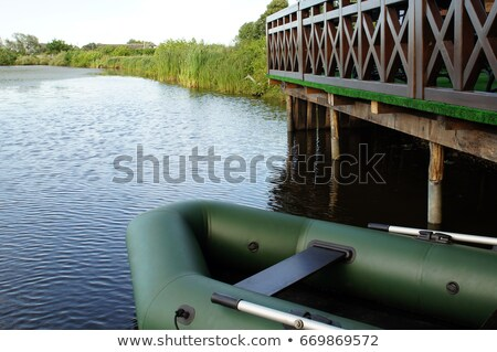 rubber boat on the lake stock photo © basel101658