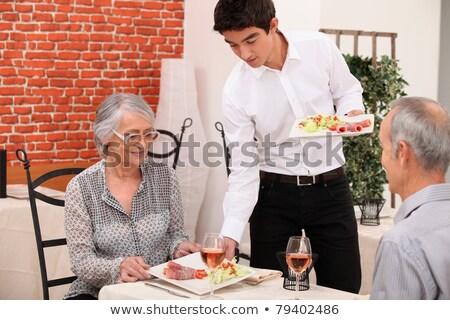 Couple de personnes âgées servi alimentaire restaurant femme vin Photo stock © photography33