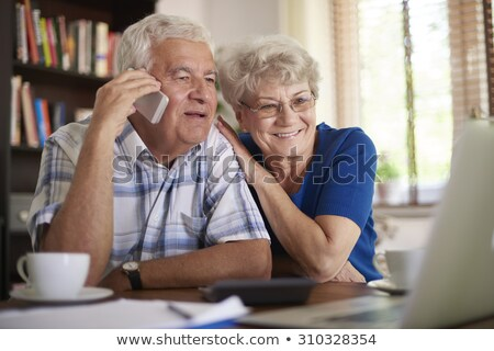 Woman dealing with two phone calls Stock photo © photography33