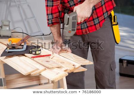 Tradesman using a power tool Stock photo © photography33