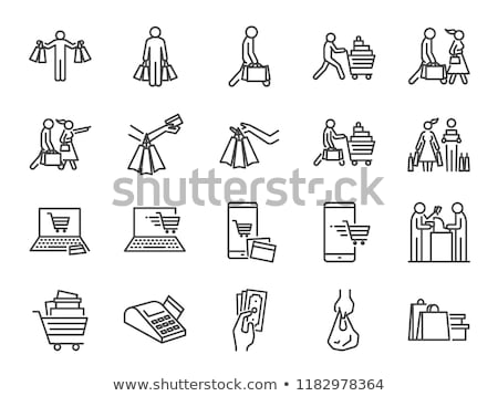 Man hand holding shopping cart icon Stock photo © vlad_star