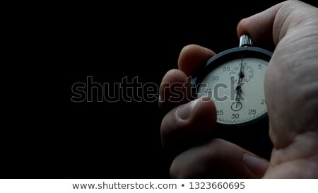Man with a stopwatch Stock photo © photography33